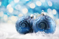Christmas decoration blue baubles on defocused background of lights Royalty Free Stock Photos