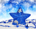 Christmas decoration blue in the shape star Royalty Free Stock Photos