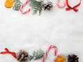 Christmas decoration. Branch tree, cones and candy on snow. Top view, flat lay Royalty Free Stock Photo