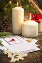 Christmas decoration with candles and greeting card ornaments Royalty Free Stock Photography