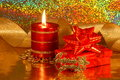 Christmas decoration card stock photo xmas candle and red gift box on gold blur background Royalty Free Stock Images