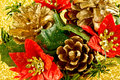 Christmas decoration a closeup of a red and golden pin cone and poinsettia Stock Image