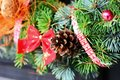 Christmas decoration closeup shot with wreath and pine cone Stock Images