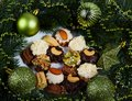 Christmas decoration cookies and a green twig Royalty Free Stock Photo