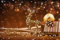 Christmas decoration with deer background gifts and golden Royalty Free Stock Images