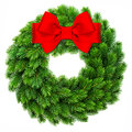 Christmas decoration evergreen wreath wit red ribbon bow Royalty Free Stock Photo