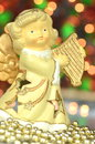 Christmas decoration figure of angel playing the harp against bokeh background Royalty Free Stock Image