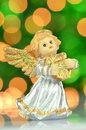Christmas decoration figure of angel playing the harp against bokeh background Stock Image
