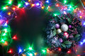 Christmas decoration with fir and baubles and fairy lights Royalty Free Stock Images