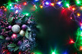 Christmas decoration with fir and baubles and fairy lights Stock Photo