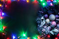 Christmas decoration with fir and baubles and fairy lights Stock Images