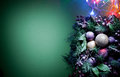 Christmas decoration with fir and baubles over green background Stock Photography