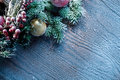 Christmas decoration with fir and baubles over wooden background Stock Photography