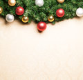 Christmas decoration with fir and baubles on paper Royalty Free Stock Photo
