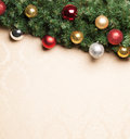 Christmas decoration with fir and baubles on a water colour paper Royalty Free Stock Images