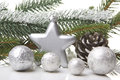 Christmas decoration with fir branch pine cones star silver Stock Image