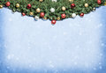 Christmas decoration with fur and baubles baubleso over snow background Stock Photos
