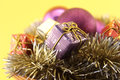 Christmas decoration with gift and baubles conceptual image about colorful boxes ornaments purple gold silver garlands Royalty Free Stock Photo