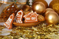 Christmas decoration with gold balls and keramic gingerbreads Stock Photos