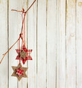Christmas decoration hanging over old wooden board Royalty Free Stock Photography
