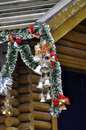 Christmas decoration hanging on wooden house roof Royalty Free Stock Photography