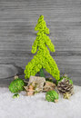 Christmas decoration with a lime green handmade tree, presents,