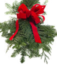 Christmas decoration of live greens and red bow Royalty Free Stock Photos
