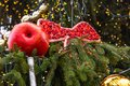 Christmas decoration made of papier mache in the form of an apple on a Christmas tree on the street of Prague