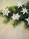 Christmas decoration merry fir tree branches with crochet snowflakes on white background Royalty Free Stock Image