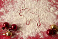 Christmas decoration - moose and red decorations Royalty Free Stock Photography