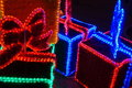 Christmas decoration neon lights in the shape of boxed gifts Stock Images