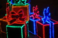 Christmas decoration neon lights in the shape of boxed gifts Stock Photos