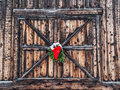 Christmas decoration on old barn of red ribbon and evergreen boughs hanging weathered door and covered with snow in jacksonville Royalty Free Stock Photos