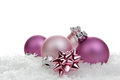 Christmas decoration pink balls with loop on artificial snow Stock Images