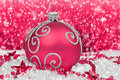 Christmas decoration pink in snow Royalty Free Stock Photos