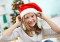 Christmas decoration portrait of smiling girl holding firtree decorations by her ears Royalty Free Stock Photos