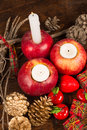 Christmas decoration with red apples their color matching a traditional Royalty Free Stock Photos