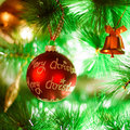 Christmas decoration red ball on tree Stock Images