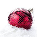 Christmas decoration with red bauble and snow with easy remova big removable sample text Stock Image