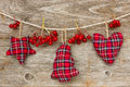 Christmas decoration with red berries on the wooden background Royalty Free Stock Images