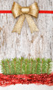 Christmas decoration with red garland canvas and fir branch on the old wood background Stock Photography