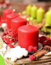 Christmas decoration with red and green candles closeup Stock Images