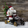 Christmas decoration red santa claus in hurry to buy christmas rush with his car shopping stress with old vintage tin toys on Royalty Free Stock Photos