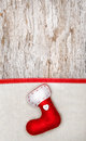 Christmas decoration with red sock ribbon and canvas on the old wood background Stock Photos