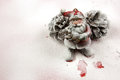 Christmas decoration santa claus figurine in the snow horizontal based on two large spruce cones on covered red surface and Stock Image
