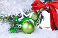 Christmas decoration with silver bell and fir branch Royalty Free Stock Photo