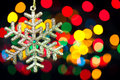 Christmas decoration snowflake on defocused lights background with copy space for text Royalty Free Stock Image