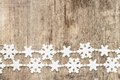 Christmas decoration snowflakes on wood plastic background Royalty Free Stock Photography