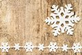 Christmas decoration snowflakes on wood plastic background Royalty Free Stock Images