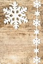 Christmas decoration snowflakes on wood plastic background Stock Image